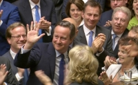 David Cameron receiving a standing ovation from his party members.
